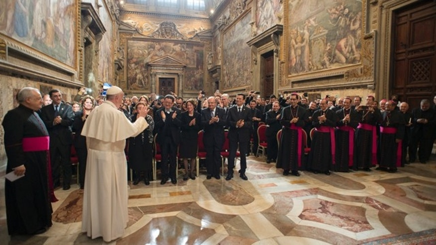 Oct. 30, 2015: Pope Francis, second from left, greets faithful during a private audience granted to participants to the pilgrimage from El Salvador at the Vatican (L'Osservatore Romano/Pool Photo via AP)