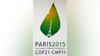 The logo of the COP21 is pictured on a banner outside the French Foreign Ministry in Paris promoting the Climate conference. The Paris conference, known as COP21, runs Nov. 30-Dec 11. (AP Photo/Jacques Brinon)
