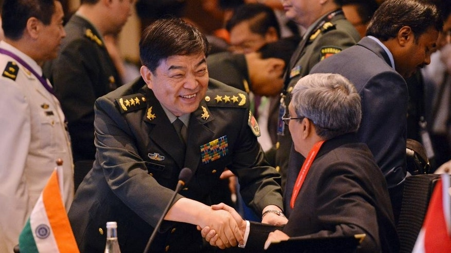 China's Defense Minister Chang Wanquan, center, shakes hands with India's Defense Minister Manohar Parrikar before the start of the Association of Southeast Asian Nations (ASEAN) Defense Ministers' Meeting Plus in Kuala Lumpur, Malaysia, Wednesday, Nov. 4, 2015. (AP Photo)