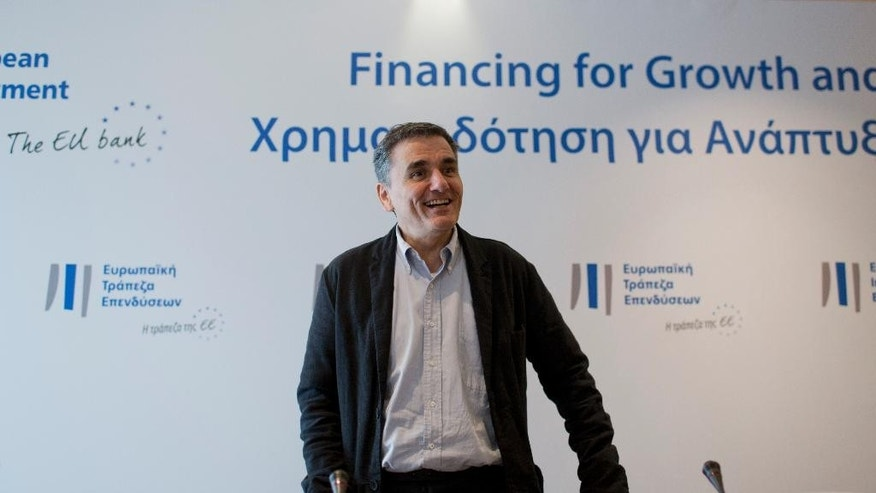 Greek finance minister Euclid Tsakalotos arrives for a press conference in Athens, on Tuesday, Nov. 3, 2015. Tsakalotos met the heads of the Luxembourg-based European Investment Bank to sign an agreement worth 285 million euros in loans for Greek energy projects. Tsakalotos is locked in talks with bailout lenders, currently held up a disagreement over how to deal with a growing number of distressed mortgages. (AP Photo/Petros Giannakouris)