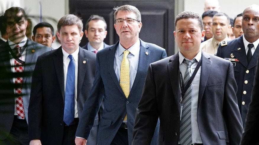 U.S. Defense Secretary Ash Carter, center, walks back to the meeting hall after the break in the Association of Southeast Asian Nations (ASEAN) Defense Ministers' Meeting Plus in Kuala Lumpur, Malaysia, Wednesday, Nov. 4, 2015. (AP Photo/Lai Seng Sin)