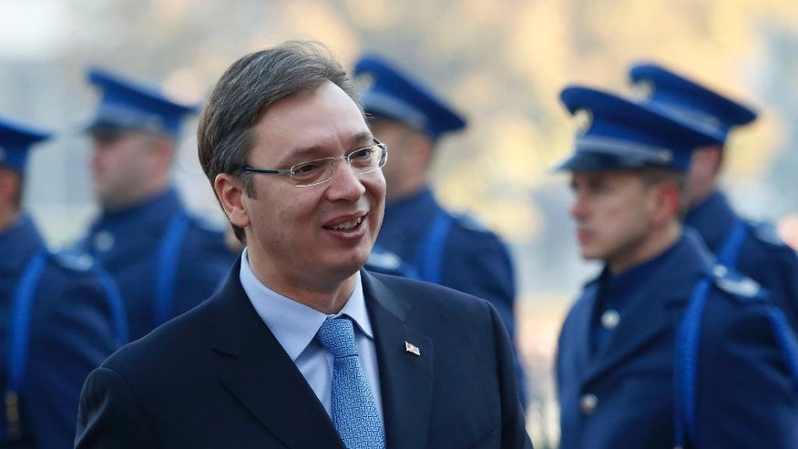 Serbia's Prime Minister Aleksandar Vucic, accompanied by Bosnian Prime Minister Denis Zvizdic, inspect the honor guard, during an  official welcoming ceremony in Sarajevo , Bosnia, Wednesday, Nov. 4, 2015.  Members of the Serbian Government, led by Prime Minister Aleksandar Vucic arrived in  Sarajevo to attend meetings  with Bosnian ministers  on the development of furthering relationships between the  governments of the two countries. (AP Photo/Amel Emric)