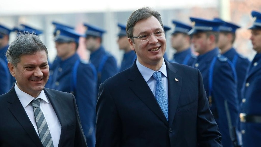 Serbia's Prime Minister Aleksandar Vucic, right,  accompanied by Bosnian Prime Minister Denis Zvizdic, left, inspect the honor guard, during an  official welcoming ceremony in Sarajevo , Bosnia, Wednesday, Nov. 4, 2015.  Members of the Serbian Government, led by Prime Minister Aleksandar Vucic arrived in  Sarajevo to attend meetings  with Bosnian ministers  on the development of furthering relationships between the  governments of the two countries. (AP Photo/Amel Emric)