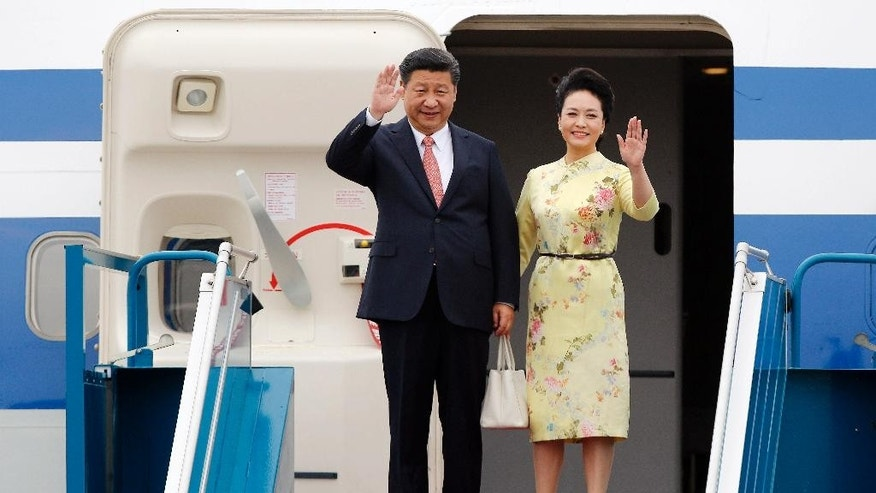 China's President Xi Jinping and his wife Peng Liyuan arrive at Noi Bai International Airport in Hanoi, Vietnam, Thursday, Nov. 5, 2015. Xi's visit to Vietnam on Thursday comes as the two communist countries seek to mend ties strained over territorial disputes in the South China Sea. (Luong Thai Linh/Pool Photo via AP)