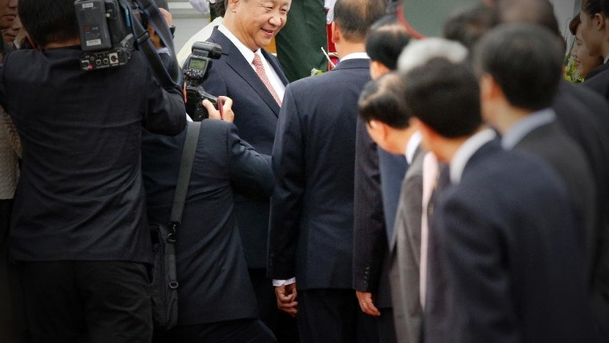 China's President Xi Jinping, center, arrives at Noi Bai International Airport in Hanoi, Vietnam, Thursday, Nov. 5, 2015. Xi's visit to Vietnam on Thursday comes as the two communist countries seek to mend ties strained over territorial disputes in the South China Sea. (Luong Thai Linh/Pool Photo via AP)