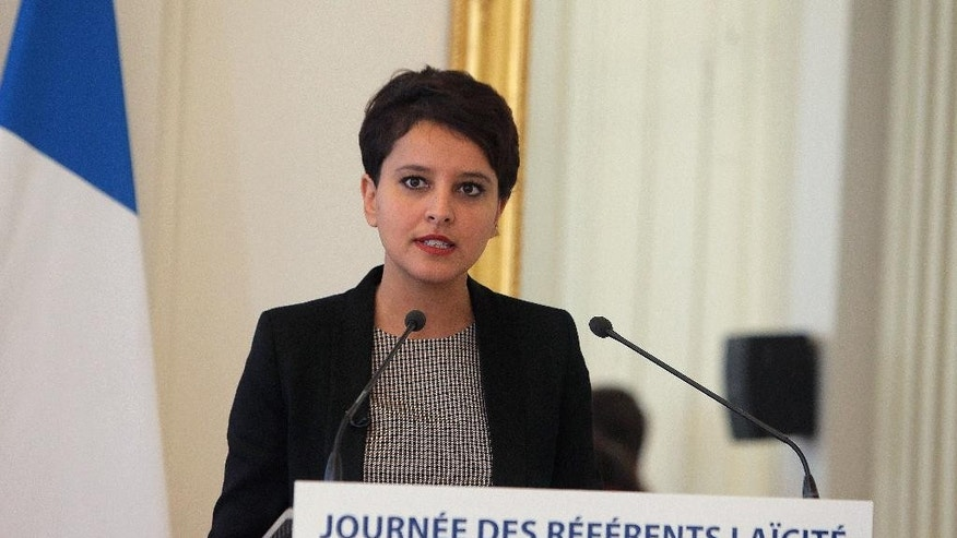 France's Education Minister Najat Vallaud-Belkacem speaks during a debate on the secularism in school, at the Jean Zay college, in Paris, France, Wednesday, Nov. 4, 2015. The school door and the cafeteria menu are the new front lines in the anguished debate over religion in France, where children in one Paris suburb this week were denied alternatives to pork in the name of secularism. (AP Photo/Thibault Camus)