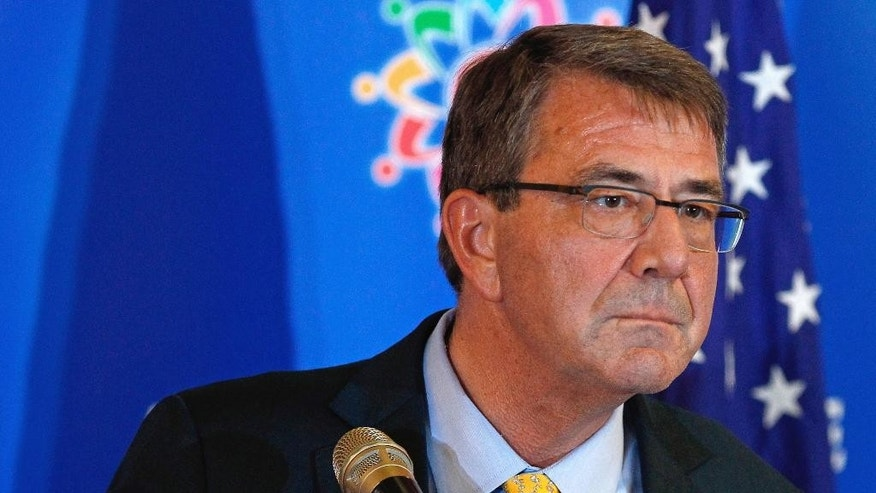 Defense Secretary Ash Carter listens to a question during a news conference after the Association of Southeast Asian Nations (ASEAN) Defense Ministers' Meeting Plus in Kuala Lumpur, Malaysia, Wednesday, Nov. 4, 2015. In a symbolic swipe at China's muscular moves in the South China Sea, Carter was flying Thursday onto the USS Theodore Roosevelt, an American aircraft carrier in the disputed waterway. Carter is using the visit to the USS Theodore Roosevelt to amplify the U.S. view that China is making excessive claims that nearly all of the South China Sea as its territory. (AP Photo/Lai Seng Sin)