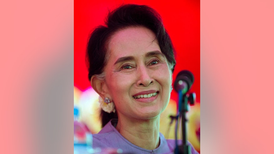 Myanmar's opposition leader Aung San Suu Kyi smiles as she addresses the media at a press conference at her home in Yangon, Myanmar, Thursday, Nov. 5, 2015. On Sunday Myanmar will hold what is being viewed as the country's best chance for a free and credible election in a quarter of a century.(AP Photo/Mark Baker)