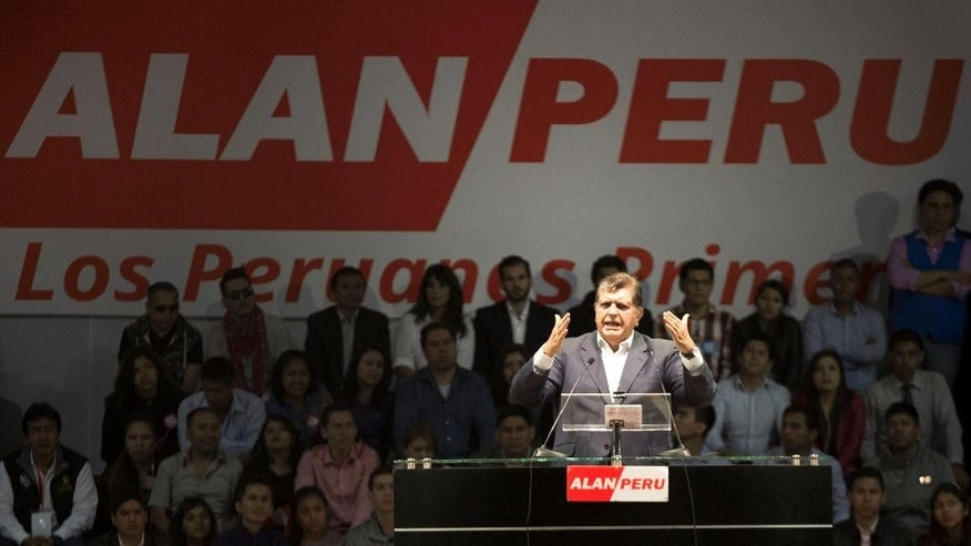 "In this Oct. 30, 2015 photo, Peru's former President Alan Garcia, who's running for a third term, speaks to supporters at a campaign rally in Lima, Peru. As Garcia seeks a third term, what have become known as the ""narco pardons"" are haunting him, with the officials who arranged them on trial accused of running a get-out-of-jail-for-pay scheme. (AP Photo/Martin Mejia)"
