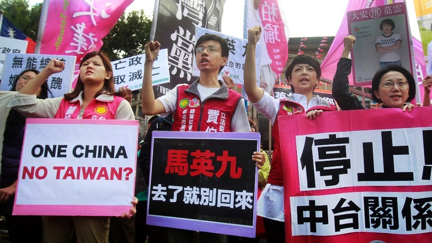 Nov. 4, 2015: Opposition protesters shout slogans with placards opposing the planned meeting of Taiwan's President Ma Ying-jeou with his China counterpart Xi Jinping in Taipei, Taiwan.
