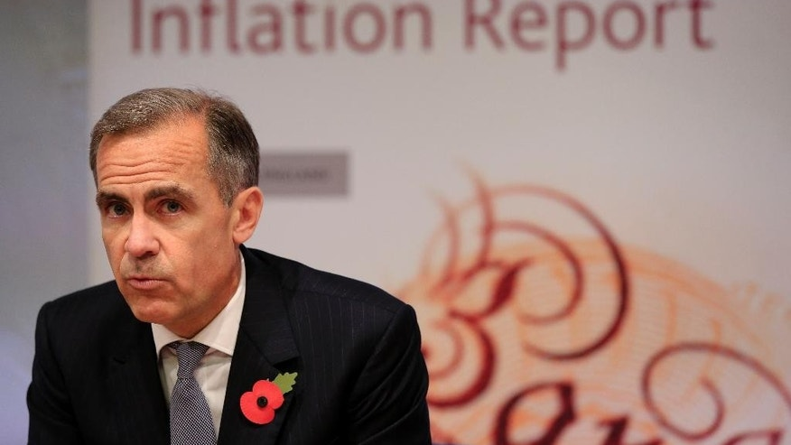 Governor of the Bank of England Mark Carney speaks during an Inflation Report press conference, at the Bank of England, in London, Thursday Nov. 5, 2015. The Bank of England refrained Thursday from raising its interest rate from a record low of 0.5 percent as weak inflation make the timing of a first increase ever more uncertain _ signaling it could even stretch to 2017. (Jonathan Brady/Pool Photo via AP)