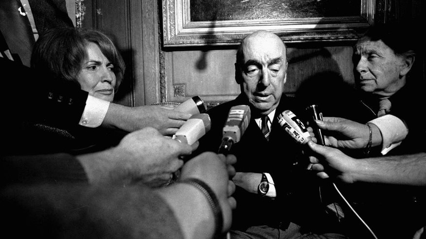 FILE - This Oct. 21, 1971 file photo shows Pablo Neruda, poet and then Chilean ambassador to France, talk with reporters in Paris after being named the 1971 Nobel Prize for Literature. Chile's government is acknowledging that Neruda might have been killed after the 1973 coup that brought Gen. Augusto Pinochet to power. The Chile's Interior Ministry released a statement Thursday, Nov. 5, 2015, amid press reports that Neruda might not have died of cancer . (AP Photo/Laurent Rebours, File)