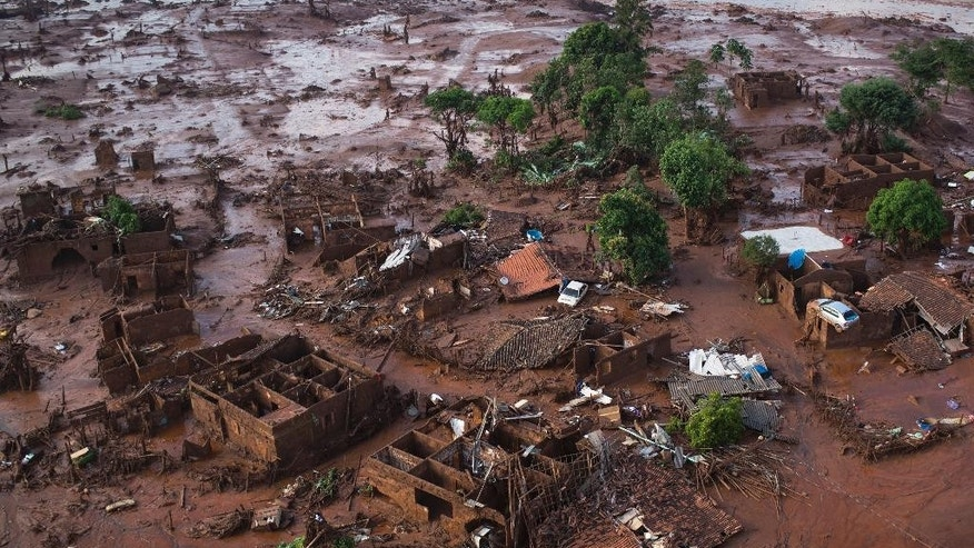 Aerial view of the debris after a dam burst on Thursday, at the small town of Bento Rodrigues in Minas Gerais state, Brazil, Friday, Nov. 6, 2015.  Brazilian rescuers searched feverishly Friday for possible survivors after two dams burst at an iron ore mine in a southeastern mountainous area.  (AP Photo/Felipe Dana)