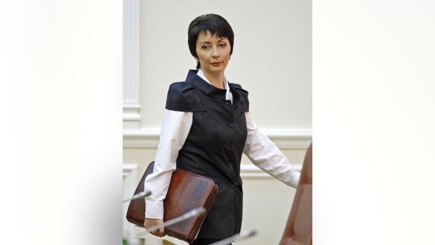 In this photo made in August 2013, former Justice Minister Olena Lukash at a cabinet meting in Kiev, Ukraine. Ukraine's Security Service says former Justice Minister Olena Lukash has been detained in connection with a probe into deadly shootings during opposition protests in 2014. (AP Photo/Volodymyr Donsov)