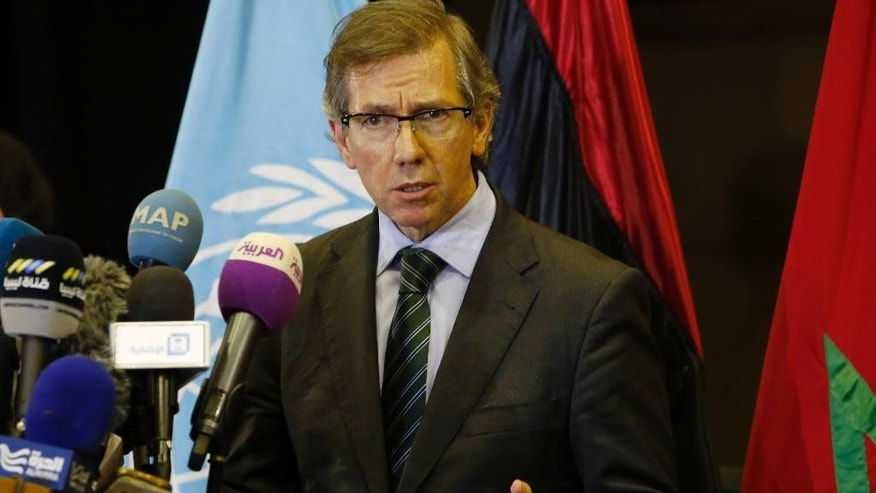 FILE - In a Wednesday, Oct. 7, 2015 file photo, United Nations envoy for Libya Bernardino Leon gestures as he speaks to the media in Skhirat, Morocco.  Libya's Islamist authorities said Thursday, Nov. 5, 2015, that they are shocked to learn that Leon, the U.N. envoy to their war-torn country, has accepted a job from the United Arab Emirates, which backs their main political rival, the internationally recognized government. (AP Photo/Abdeljalil Bounhar, File)