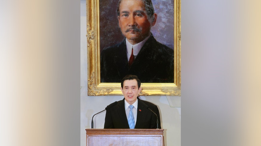 Standing under a portrait of the founding father of the Republic of China Dr. Sun Yat-sen, Taiwan's President Ma Ying-jeou addresses media during a press conference detailing his planned meeting with China's President Xi Jinping at the Presidential Office in Taipei, Taiwan, Thursday, Nov. 5, 2015.  Taiwanese President Ma Ying-jeou is running into skepticism at home over his impending historic meeting with China's president Xi Jinping, aimed at locking in the dialogue that he has built, from zero, with Beijing during his nearly eight years in office. (AP Photo/Chiang Ying-ying)