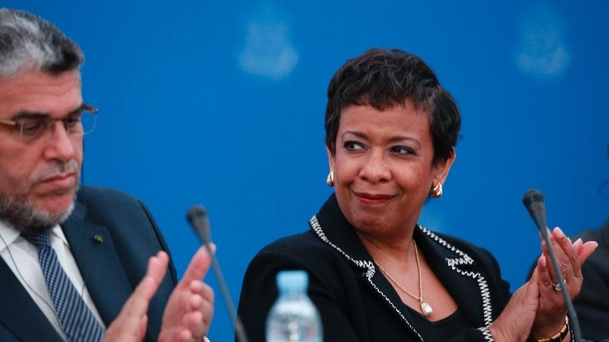Mustapha Ramid, Moroccan Minister of Justice left, and US Attorney General Loretta Lynch applaud during the  Workshop on International judicial cooperation in Rabat, Morocco, Thursday, Nov. 5, 2015. Younis Abdurrahman Chekkouri, who spent 13 years in Guantanamo without being charged has been held for more than six weeks without formal charges in Morocco despite what his lawyers say were U.S. government assurances that he would be quickly released upon his return home. (AP Photo/Abdeljalil Bounhar)