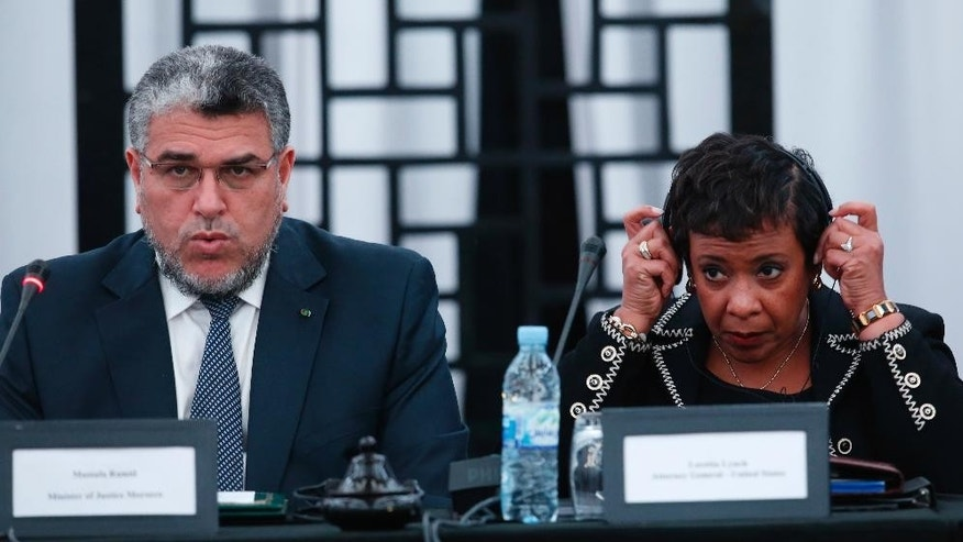 Mustapha Ramid, Moroccan Minister of Justice left, speaks as US Attorney General Loretta Lynch listens during the  Workshop on International judicial cooperation in Rabat, Morocco, Thursday, Nov. 5, 2015. Younis Abdurrahman Chekkouri, who spent 13 years in Guantanamo without being charged has been held for more than six weeks without formal charges in Morocco despite what his lawyers say were U.S. government assurances that he would be quickly released upon his return home. (AP Photo/Abdeljalil Bounhar)