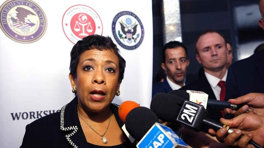 US Attorney General Loretta Lynch answer reporters during the  workshop on international judicial cooperation in Rabat, Morocco, Thursday, Nov. 5, 2015. Younis Abdurrahman Chekkouri, who spent 13 years in Guantanamo without being charged has been held for more than six weeks without formal charges in Morocco despite what his lawyers say were U.S. government assurances that he would be quickly released upon his return home. (AP Photo/Abdeljalil Bounhar)