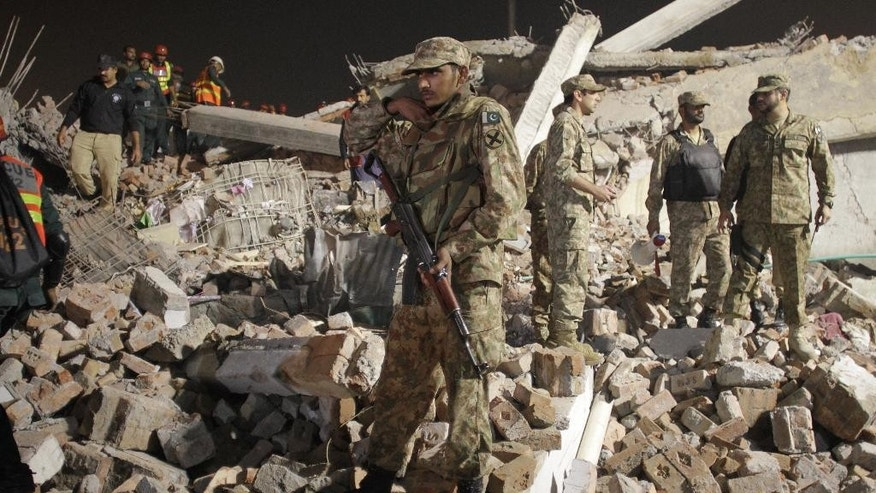 Pakistan army soldiers take part in rescue work.
