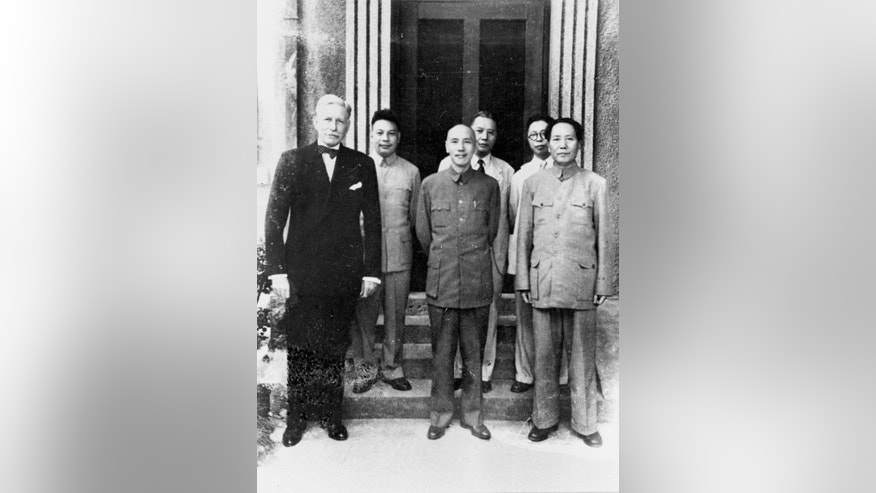 In this 1945 photo provided by the Central News Agency, China's Nationalist President Chiang Kai-shek, center, and his Communist rival Mao Zedong, right, stand together with US ambassador to China Patrick J. Hurley in Chongqing, China. Seventy years later, presidents of those two sides _ Taiwan's Ma Ying-jeou and mainland China's Xi Jinping _ will hold their first meeting Saturday, Nov. 7, 2015 in Singapore. (Central News Agency via the AP)