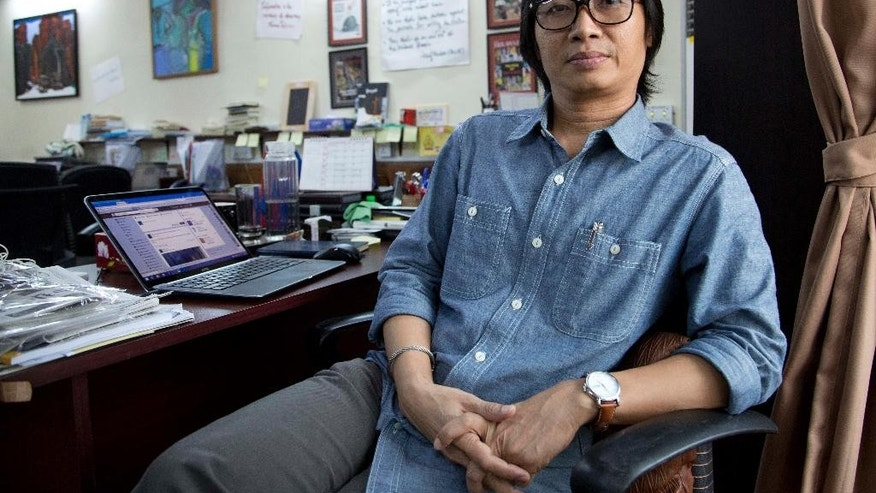 In this Monday Nov. 2, 2015 photo Kyaw Zwa Moe, editor of The Irrawaddy, sits at his desk in his newsroom in Yangon, Myanmar. Their predecessors suffered torture, imprisonment and death at the hands of a die-hard military regime for more than half a century. Now, Myanmar's journalists, newly fledged, muscle-flexing but also still apprehensive are challenged with the first general election since 1960 to be covered with relative freedom.  (AP Photo/Mark Baker)