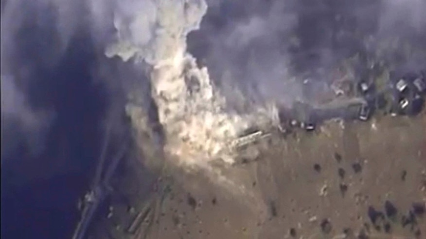Nov. 2, 2015: This photo made from the footage taken from Russian Defense Ministry official web site shows a target hit during s Russian air raid in Syria.