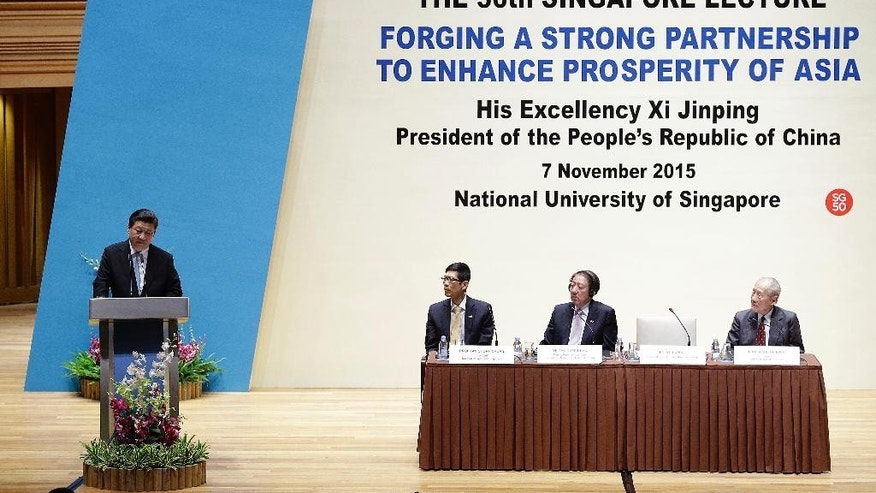 "Chinese President Xi Jinping, left, delivers his speech on ""Forging A Strong Partnership To Enhance Prosperity Of Asia"" at the 36th Singapore Lecture on Saturday, Nov. 7, 2015, in Singapore. (AP Photo/Wong Maye-E)"