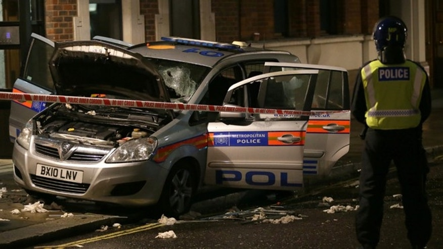 Nov. 5, 2015: A damaged police car in Westminster during the Million Mask protest march in London.