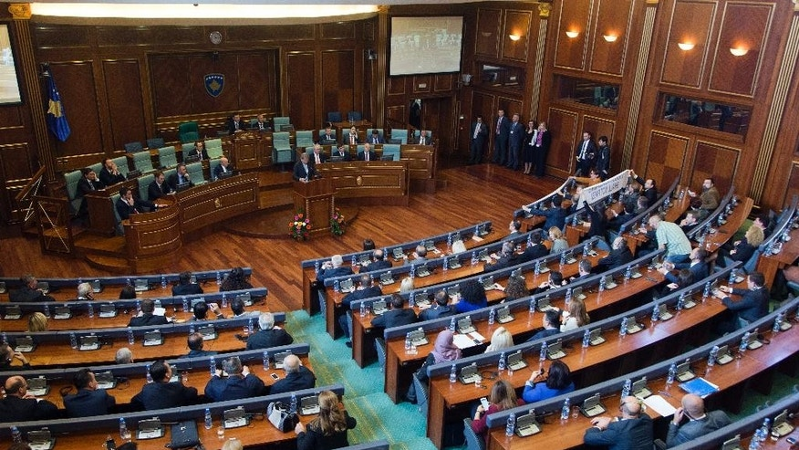 EU Commissioner for European Neighbourhood Policy & Enlargement Negotiations Johannes Hahn addresses lawmakers in Kosovo parliament in capital Pristina on Friday, Nov. 6, 2015. Hahn has warned Kosovo opposition members that blocking Parliament will hamper the country's further integration into the 28-nation bloc.(AP Photo/Visar Kryeziu)