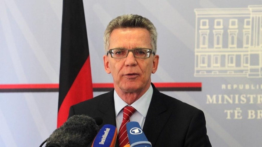 German Interior Minister Thomas de Maiziere speaks at a news conference after meeting with Albanian counterpart Saimir Tahiri, in Tirana, Friday, Nov. 6, 2015.  De Maiziere calls on Albanians to stop asking for political asylum in Germany as there is no ground for their claims. (AP Photo/Hektor Pustina)