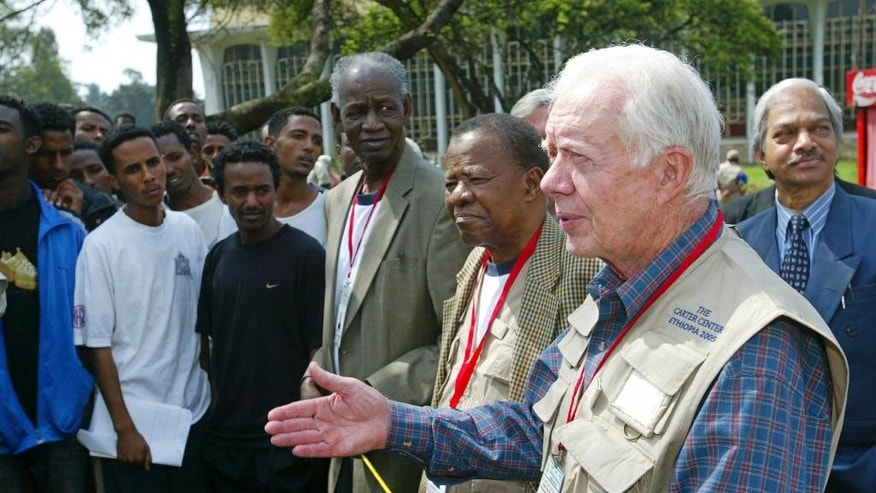 FILE - In this May 15, 2005 file photo, former U.S. President Jimmy Carter, right, former Botswanan President, Ketumile Joni Masire, center, and former Tanzanian Prime Minister, Joseph Warioba, fourth from right address members of the media at a polling station at the university in Addis Ababa, during the third democratic elections in Ethiopia's 3,000-year history. Afflicted by cancer, former President Jimmy Carter won't be present for Myanmar's watershed election Sunday. But the center founded will, monitoring a vote in a crisis-ridden corner of the world for the 101st time to ensure polling is free and credible. (AP Photo/Karel Prinsloo,File)