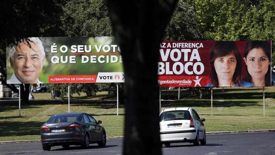 "In this  Oct. 1 2015 photo, cars drive by election posters of the Portuguese Socialist Party, left, and the Left Bloc in Lisbon during the election campaign. Poster on the left shows Socialist leader Antonio Costa and the slogan ""It's your vote that decides"". Poster on the right shows party leader Catarina Martins and member of parliament Mariana Mortagua, right, and the slogan ""Make the difference, Vote Bloc"". Die-hard communists are poised to walk the corridors of power in Portugal, and a new generation of leftist radicals is right beside them. (AP Photo/Armando Franca)"