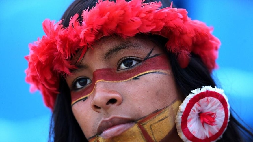 In this Oct. 28, 2015 photo, a Brazilian Pataxo indigenous woman attends the World Indigenous Games in Palmas, Brazil. Of the estimated 2,000 indigenous languages thought to have been spoken in pre-Columbian times in what is now Brazil, only around 160 survive today. Portuguese is now the first language of most members of the Pataxo nation. (AP Photo/Eraldo Peres)