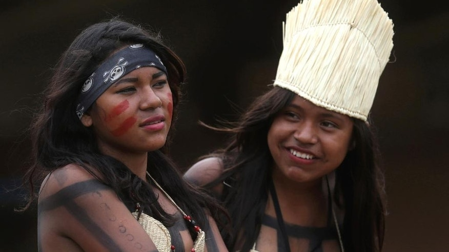 In this Oct. 23, 2015 photo, Brazil's Xerente indigenous women attend the World Indigenous Games in Palmas, Brazil. While the country's indigenous population was thought to have numbered from 3 million-5 million in pre-Columbian days, five centuries of disease, violence and poverty have whittled the population to under 1 million. Now, Brazil's original inhabitants make up under 0.5 percent of this country of 200 million. (AP Photos/Eraldo Peres)