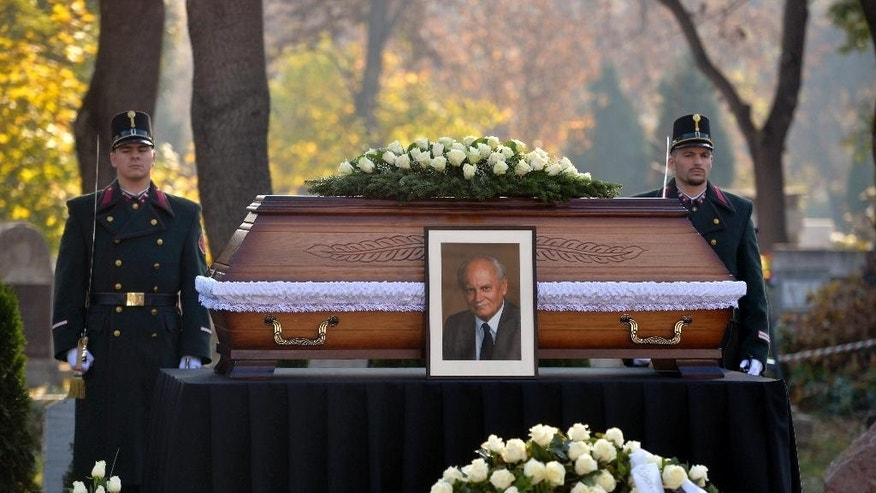The coffin of former Hungarian President Arpad Goncz is pictured during a funeral service in the Obuda Cemetery of Budapest, Hungary, Friday, Nov. 6, 2015. Goncz died on Oct. 6 at the age of 93. (Szilard Koszticsak/MTI via AP)