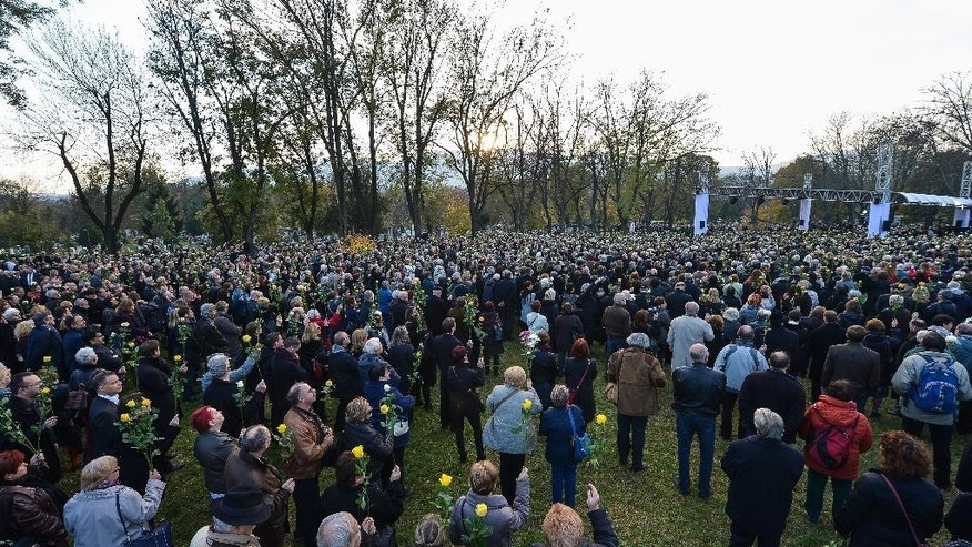 Mourners attend the funeral of former Hungarian President Arpad Goncz at the Obuda Cemetery of Budapest, Hungary, Friday, Nov. 6, 2015. Goncz died on Oct. 6 at the age of 93. (Tibor Illyes/MTI via AP)