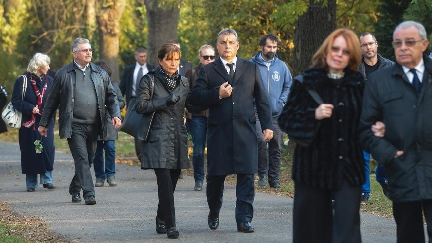 Hungarian Prime Minister Viktor Orban, centre right, and his wife Aniko Levai, center left, arrive at the funeral of former Hungarian President Arpad Goncz at the Obuda Cemetery of Budapest, Hungary, Friday, Nov. 6, 2015. Goncz died on Oct. 6 at the age of 93. (Tibor Illyes/MTI via AP)
