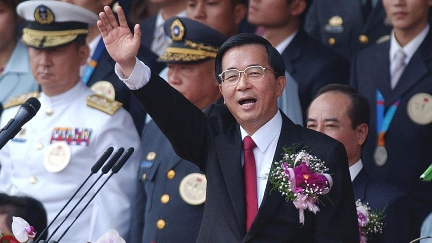 File - In this Oct. 10, 2004 file photo, Taiwan President Chen Shui-bian waves to the audience after giving a speech during National Day celebrations in front of the Presidential Building in Taipei, Taiwan. China and Taiwan have been separately ruled since the Chinese civil war of the 1940s, but China claims sovereignty over the island and insists the two sides eventually unify. They have in recent years set aside that dispute to build trust and sign economic cooperation deals, and their presidents will meet for the first time Saturday, Nov. 7, 2015, in Singapore.  (AP Photo/Wally Santana, File)