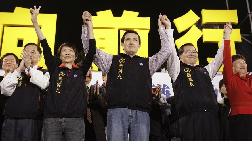 File - In this Mar. 22, 208, file photo, Taiwan's opposition Nationalist Party presidential candidate Ma Ying-jeou, center, Vice presidential candidate Vincent Siew, second from right, Ma's wife Chou Mei-chin, second from left, celebrate after winning the presidential election at Taipei, Taiwan. China and Taiwan have been separately ruled since the Chinese civil war of the 1940s, but China claims sovereignty over the island and insists the two sides eventually unify. They have in recent years set aside that dispute to build trust and sign economic cooperation deals, and their presidents will meet for the first time Saturday, Nov. 7, 2015, in Singapore. (AP Photo/Vincent Yu, File)
