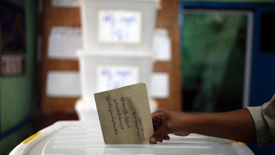 FILE - In this Friday, Oct. 30, 2015, file photo, a man casts his ballot in advance of the upcoming Nov. 8 general election at a township Election Commission Office in Mandalay, Myanmar. Myanmar will hold general elections on Sunday to choose representatives for both houses of Parliament, known as Pyidaungsu Hluttaw. (AP Photo/Hkun Lat, File)
