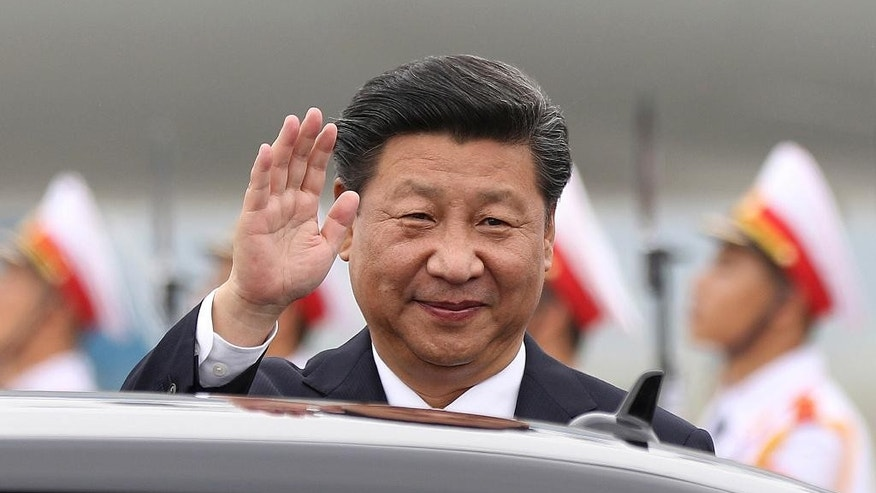 FILE- In this Thursday, Nov. 5, 2015, file photo, China's President Xi Jinping waves as he arrives at Noi Bai International Airport in Hanoi, Vietnam. The leaders of China and Taiwan met Saturday in a historic first since their territories split during the Chinese civil war in 1949.  (Minh Hoang/Pool Photo via AP)