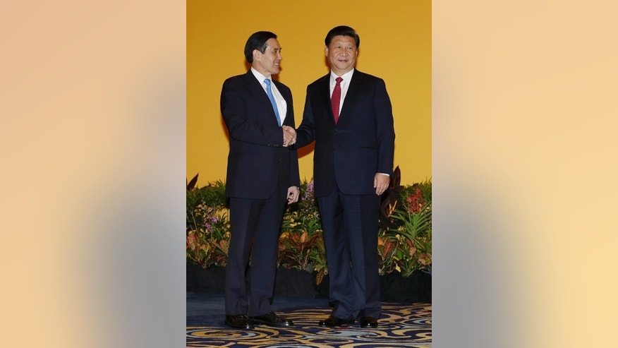 Chinese President Xi Jinping, right, and Taiwanese President Ma Ying-jeou, left, shake hands at the Shangri-la Hotel on Saturday, Nov. 7, 2015, in Singapore. The two leaders shook hands at the start of a historic meeting marking the first top level contact between the formerly bitter Cold War goes since they split amid civil war 66 years ago. (AP Photo/Wong Maye-E)
