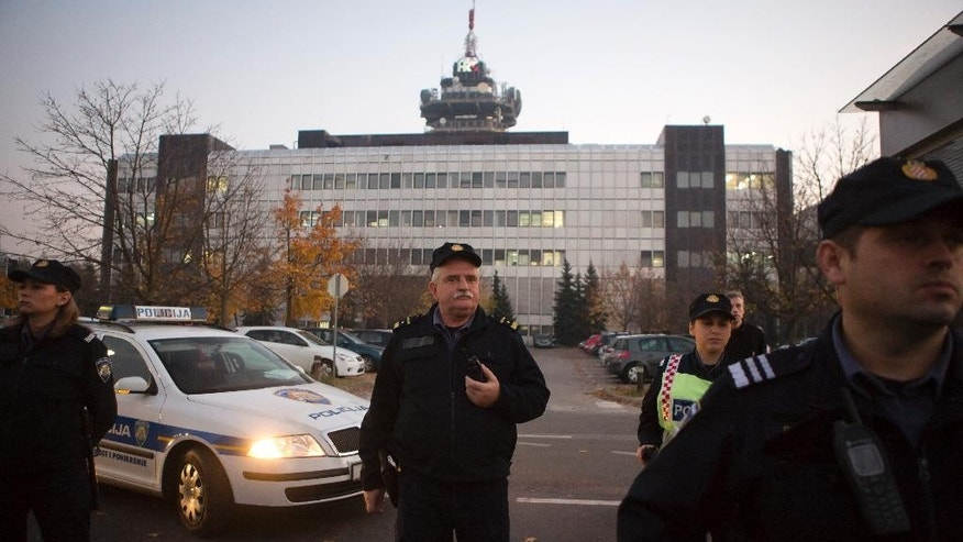 "Police secure the building of state TV as members and supporters of of ""Zivi Zid"" political party rally in Zagreb, Croatia, Friday, Nov. 6, 2015. General Elections in Croatia are scheduled for Sunday, Nov. 8. (AP Photo/Darko Bandic)"
