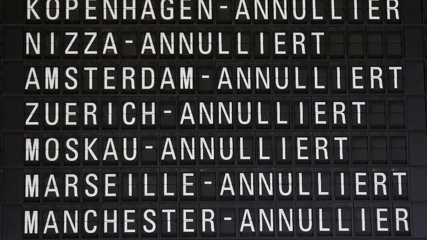 Canceled flights appear on a board at the airport  in Frankfurt, Germany, Friday, Nov. 6, 2015.  Germany's flagship airline, Lufthansa, canceled 290 flights on Friday as cabin crew workers went on strike at Frankfurt and Duesseldorf airports. The carrier said the cancellations included 23 long-haul flights, and that overall some 37,500 passengers were affected. (AP Photo/Michael Probst)