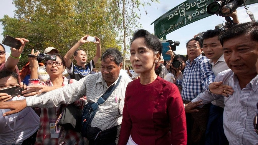 Myanmar opposition leader Aung San Suu Kyi leaves after voting at a polling station at Kaw Hmu township during the general election Sunday, Nov 8, 2015, in Yangon, Myanmar. Myanmar voted Sunday in historic elections that will test whether popular mandate can loosen the military's longstanding grip on power, even if opposition leader Suu Kyi's party secures a widely-expected victory. (AP Photo/Khin Maung Win)