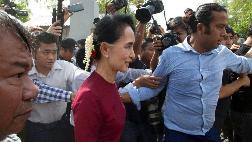 Myanmar's National League for Democracy party leader Aung San Suu Kyi visits a polling station on the outskirts of Yangon, Myanmar, Sunday, Nov. 8, 2015. Myanmar voted Sunday in historic elections that will test whether popular mandate will help loosen the military's longstanding hold on power even if opposition leader Suu Kyi's party secures a widely-expected victory. (AP Photo/Mark Baker)