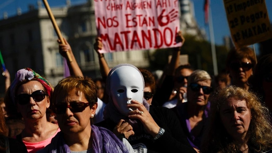 Thousands of people from all over Spain march against domestic violence after converging in Madrid, Spain, Saturday, Nov. 7, 2015. Since 1995, more than 1,390 women have been murdered in Spain by male attackers and that so far this year 84 cases of murders of women by men have been recorded. Banner reads: ' Is there anybody out there? They are killing us!'. (AP Photo/Daniel Ochoa de Olza)