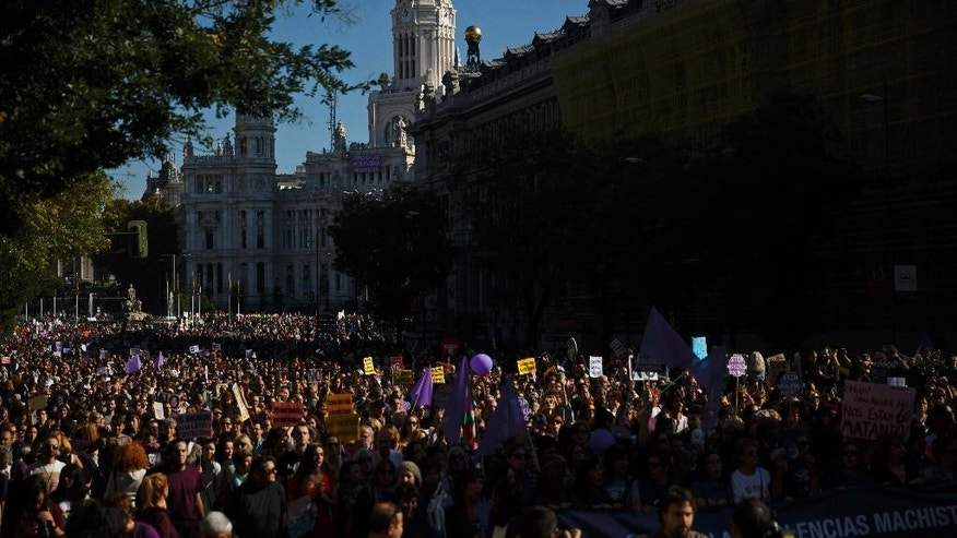 Thousands of people from all over Spain march against domestic violence, in Madrid, Spain, Saturday, Nov. 7, 2015. Since 1995, more than 1,390 women have been murdered in Spain by male attackers and that so far this year 84 cases of murders of women by men have been recorded. (AP Photo/Daniel Ochoa de Olza)