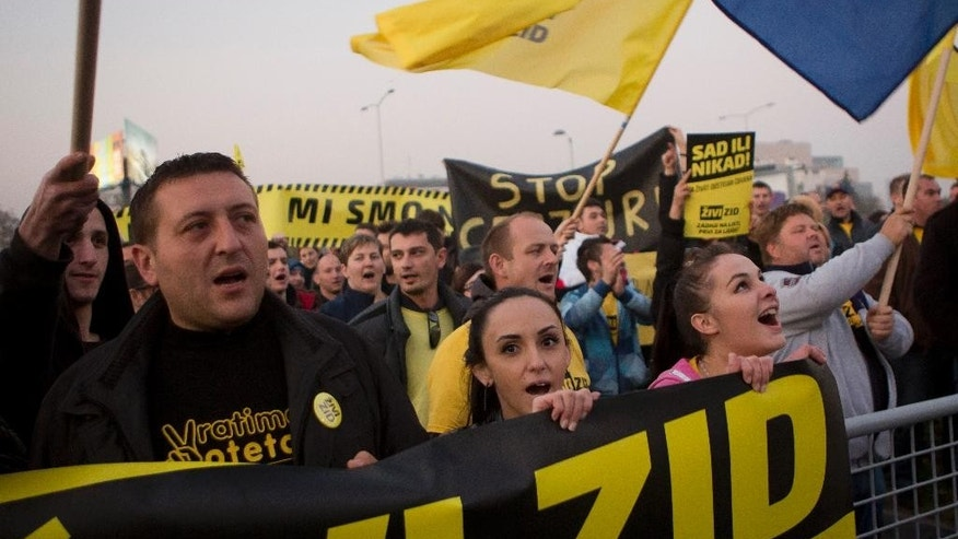 "Members and supporters of ""Zivi Zid"" political party rally in front of the building of state TV, in Zagreb, Croatia, Friday, Nov. 6, 2015.  General Elections in Croatia are scheduled for Sunday, Nov. 8. (AP Photo/Darko Bandic)"